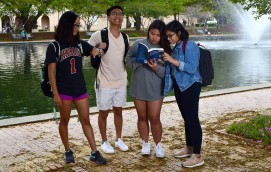 Jueling Chan, left, Martin Trinh, Cat Tran and Iverielle Legaspi get in some last minute studying while mugging for Team 2