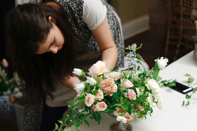 Sharon Young puts the finishing touches on a bouquet.