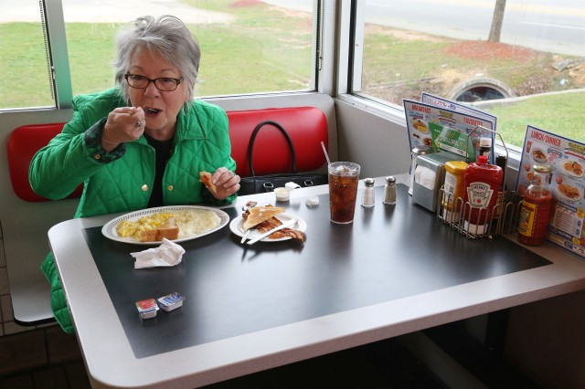 Judy Derrick, a South Carolina native, enjoys her breakfast before work.