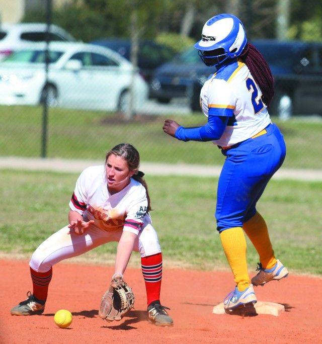Number 23, Kayla Sutton, takes second base.